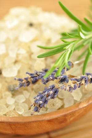 Herbal bath salt in a wooden bowl photo