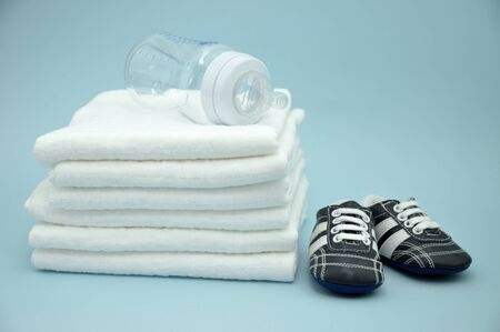 Baby bottle on cotton diapers and booties Stock Photo - 9977359