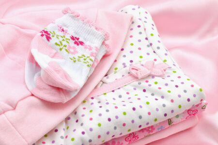 Pile of pink baby clothes photo