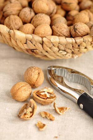 hard core: Freshly cracked walnut and nutcracker and a wicker basket full of walnuts