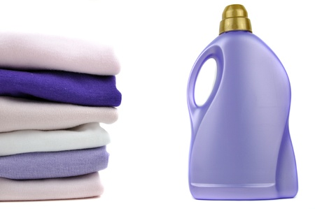 Detergent bottle and a pile of clothes