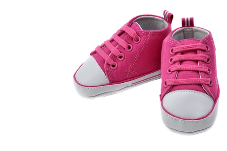 Pink baby booties, isolated on white Standard-Bild