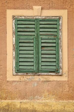 Green old wooden shutters. Slovenske Konjice, Slovenia photo