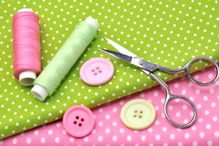 Sewing items on colorful fabrics  photo
