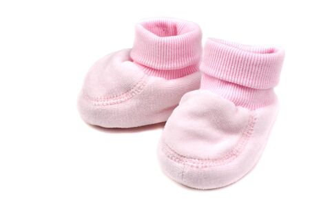 slipper: Pink baby booties, isolated on white Stock Photo