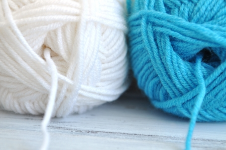 White and blue balls of yarn