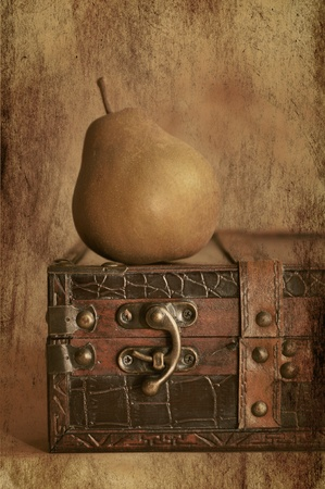 old suitcase: Pear on a vintage suitcase