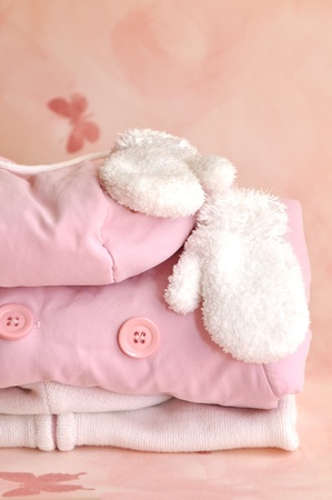 Pile of pink girlie warm winter clothes photo