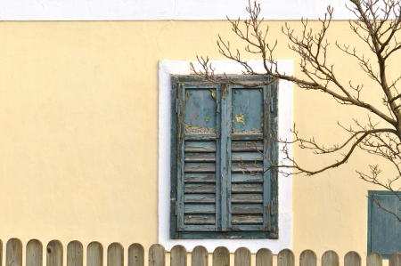 Green rustic window with closed shutters photo