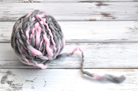 yarn: One ball of pink and gray handspun yarn Stock Photo