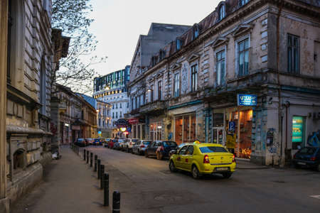 Streetlife with taxi in Bucharest, Romania. I have taken this photo in April 2018 during my visit of Romania Editöryel