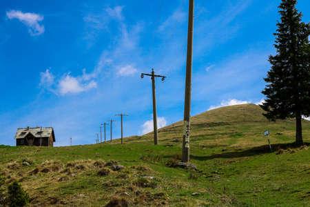 Telegraph road near Rarau Peak in Bukovina, Romania.. I have taken this photo in April 2018 during my visit of Romania