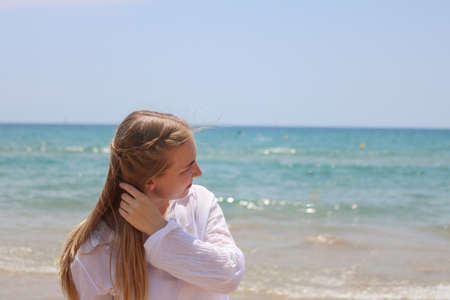 Pretty blonde woman posing on the beach