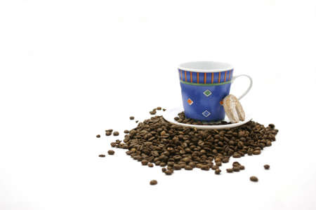 Blue cup, cookie and coffee beans