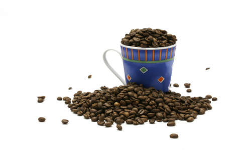Blue cup and coffee beans Stock Photo