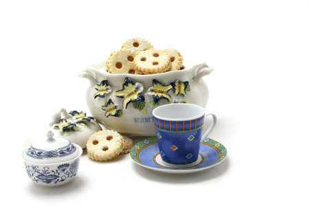 Cookie jar, with sugar bin and blue cup Stock Photo