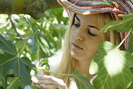 Young woman inspecting figs
