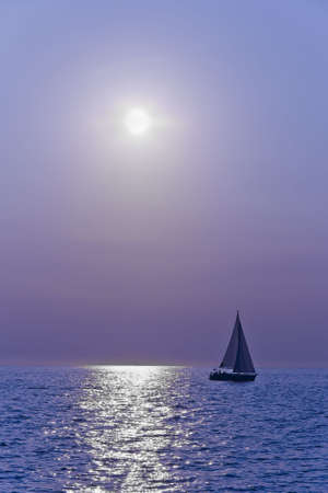 Sailboat silhuette sailing against a sunset Stock Photo - 3520254