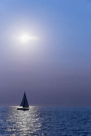 Sailboat silhuette sailing against a sunset  Stock Photo