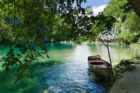 Peaceful scene, boat in the lake. Stock Photo