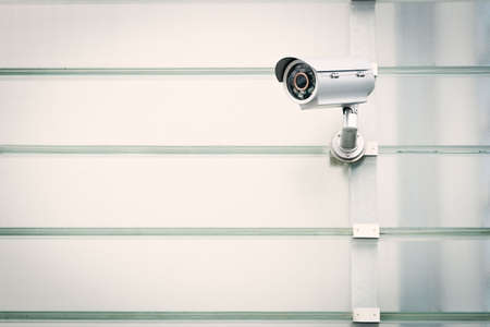 security equipment: Security camera is watching you! Stock Photo