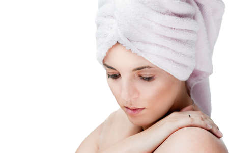 Girl with hair wrapped in a towel. Spa theme.