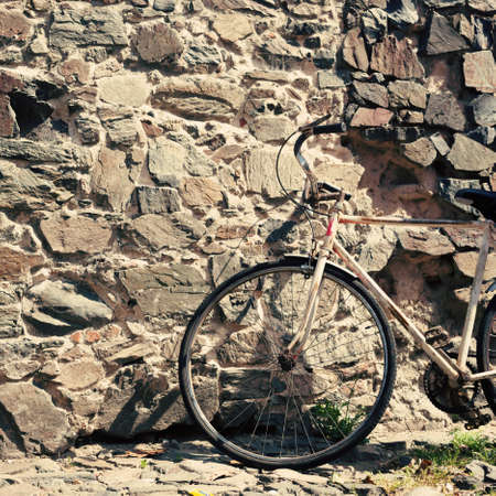 Vintage bicycle in a cobblestone street photo