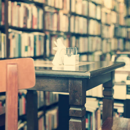 Wooden table in a bookstore photo