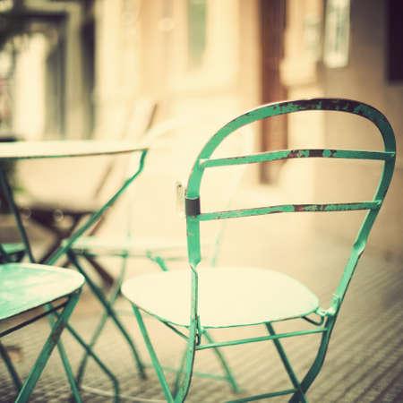 starbucks coffee: Old metal chair outdoors