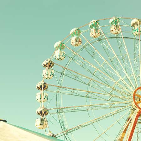 Vintage ferris wheel and tent photo