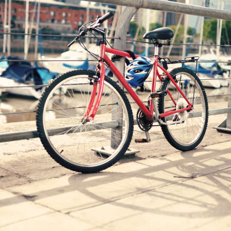 Bicycle parked by the port canal photo