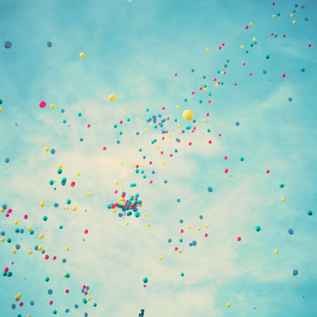 Colorful helium balloons in flight photo