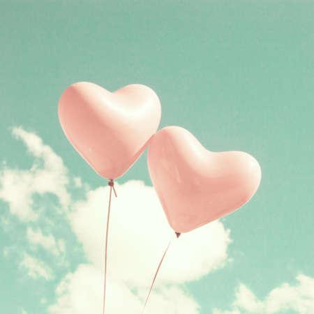 Twee hartvormige ballonnen