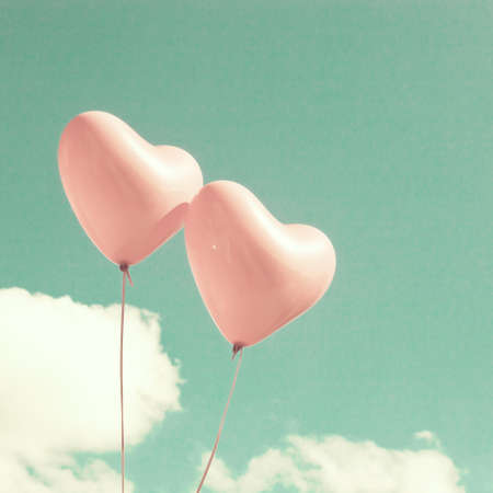 pastel color: Two heart-shaped balloons