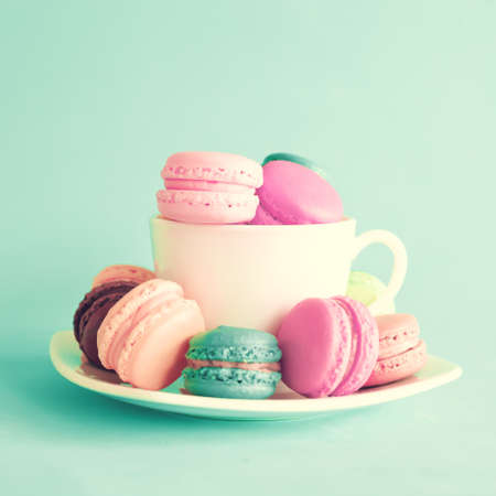 sweet pastries: Vintage tea cup with macaroons