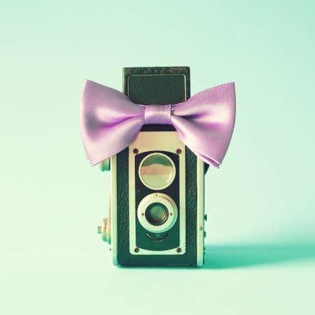 Vintage film camera with bow tie photo