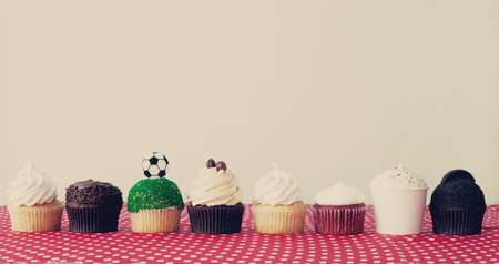 Eight cupcakes over polka dots tablecloth photo