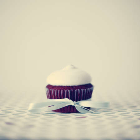 Red velvet cupcake over white background photo
