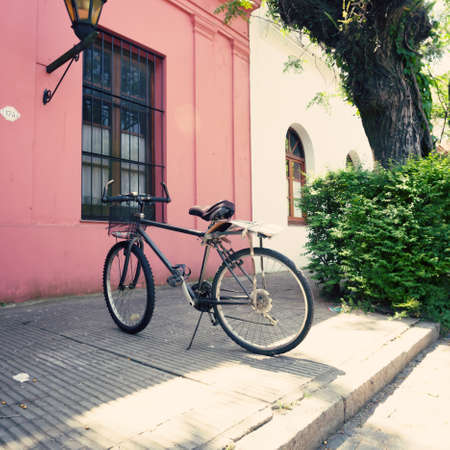 Parked bicycle in a quiet street photo
