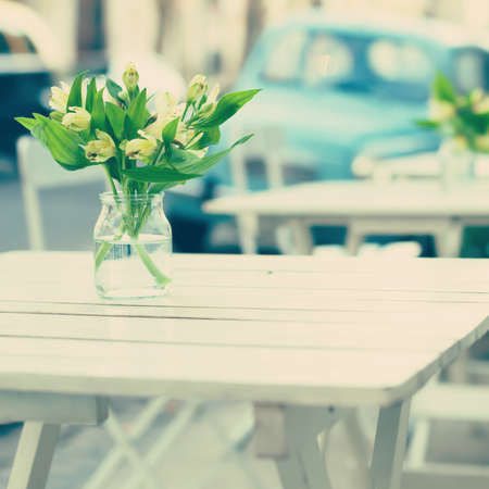 Vintage outdoors cafe tables photo
