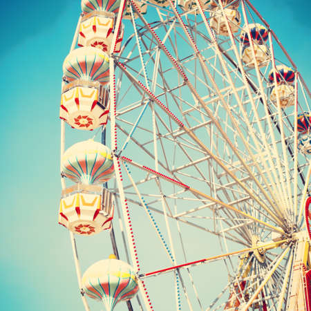 Vintage ferris wheel over blue sky