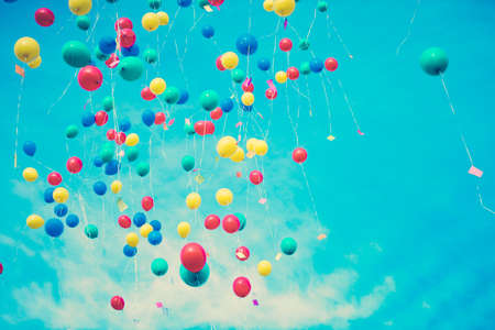 Colorful balloons flying away Stock Photo