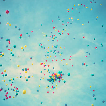birthday background: Colorful balloons flying away Stock Photo