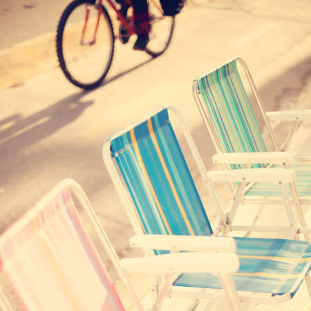 Outdoors chairs and bicycle photo