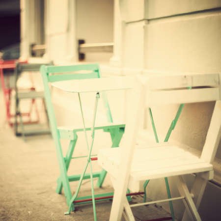 Outdoors cafe tables and chairs photo