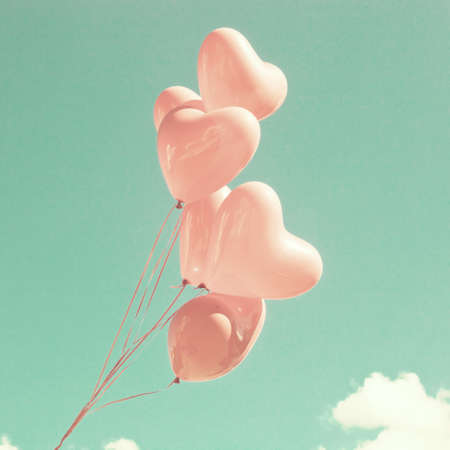 pastel colors: Bunch of pink heart-shaped balloons Stock Photo