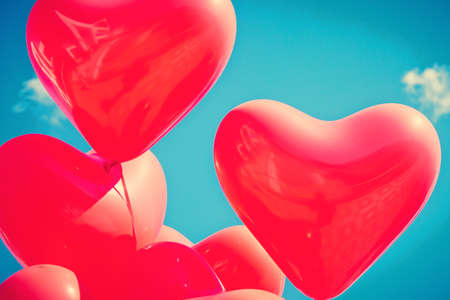 Bunch of red heart-shaped balloons