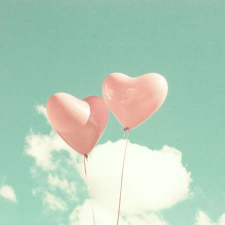 Two pink heart-shaped balloons 스톡 콘텐츠