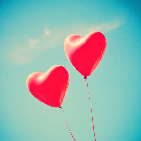 heart balloon: Two red heart-shaped balloons