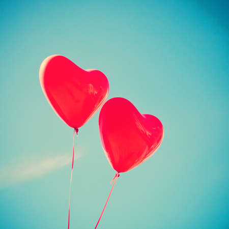 balloon background: Two red heart-shaped balloons